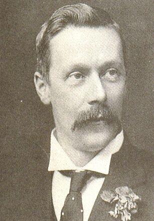 Sir Alexander Peacock KCMG